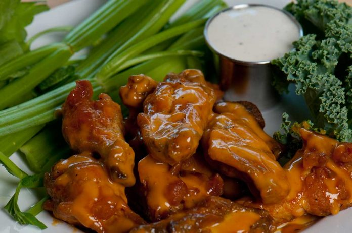 Key Lime Barbecue Wings on a plate with celery and blue cheese sauce.