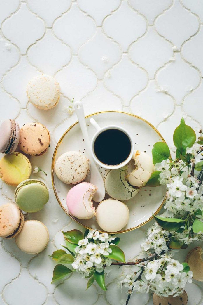 Macaroons served with a cup of coffee