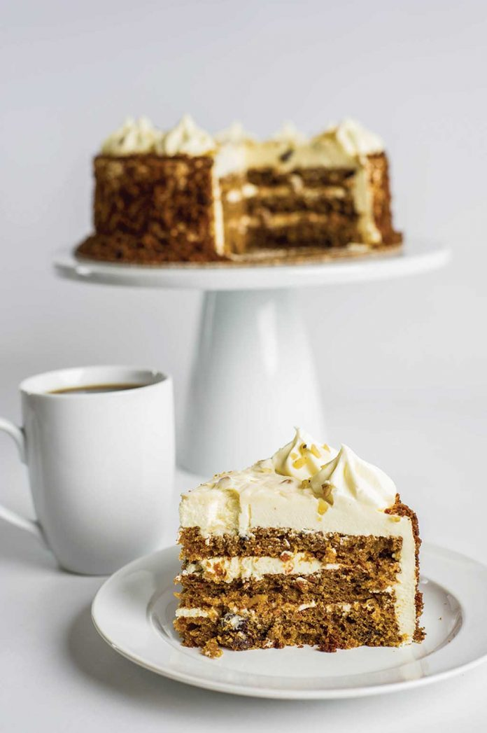 Carrot Cake with a slice on a plate in front of it