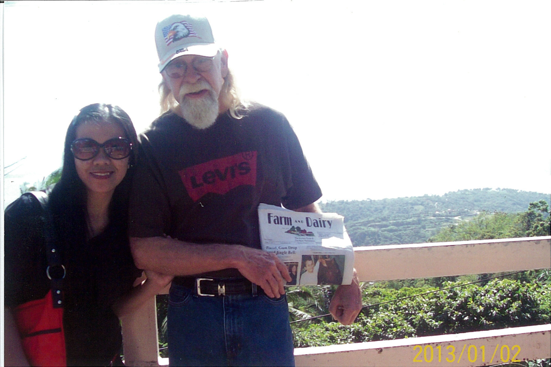 Randy Stoker, right, of Atlantic, Pa., sits with his friend Joy and the Farm and Dairy at Taal Volcano, at Tagaytay in the Phillipines. Randy visited the Phillipines from November until February.