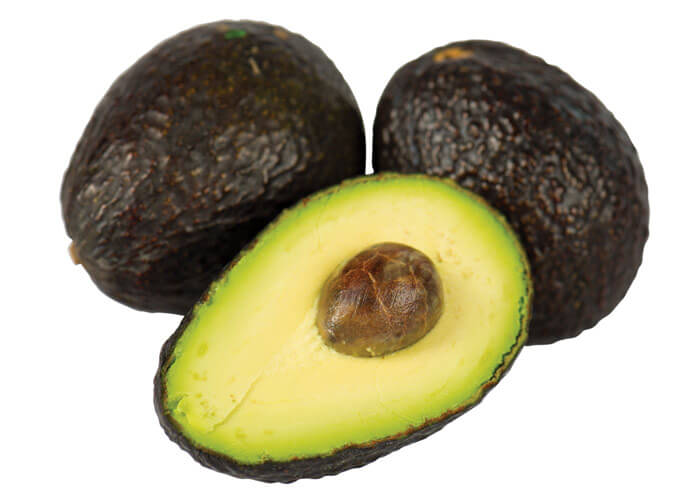 avocado, avocado cut open and avocado with seed removed