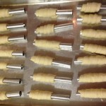 puff pastry dough on clothespin cookie forms