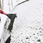 scraping snow and ice off of car windows