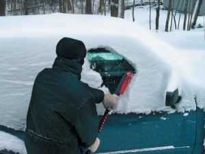 cleaning snow off of car windows