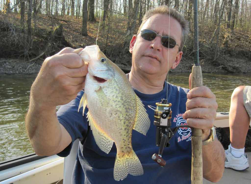 fisherman holding crappie