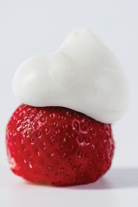 whipped cream on strawberry