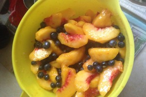 blueberries and peaches in mixing bowl