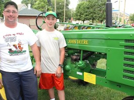 Father and son with John Deere