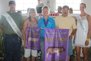 Montana Szuhay's 259-pound best of show hog sold for $6.75 a pound to Bortnick Farms, represented by Don Bortnick and Georgia Hofka.
