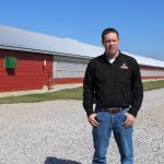 Andy Hollenback, with poultry barn