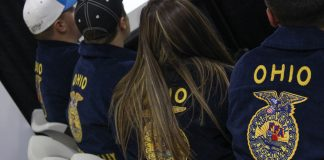 FFA members sit next to each other in chairs.