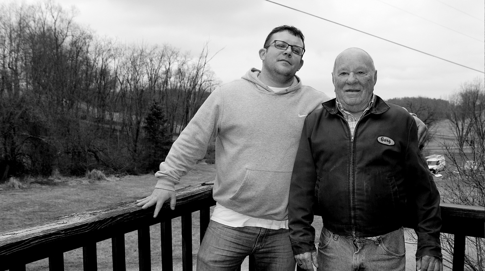 David Stanley stands next to his dad on their porch overlooking the scenic farmland that surrounds their home.