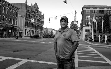 Brent Bennet stands on the corner of a Huron County street