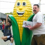 Tom and TJ Logan visiting the Corn Palace in South Dakota with the Farm and Dairy