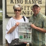The Hittles visiting King Ranch in Texas with their Farm and Dairy in hand.