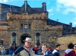 The Larricks standing in front of Edinbugh Castle in Scotland with their Farm and Dairy