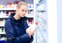 Woman buying milk at the store before a snowstorm