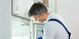 Man cleaning fridge