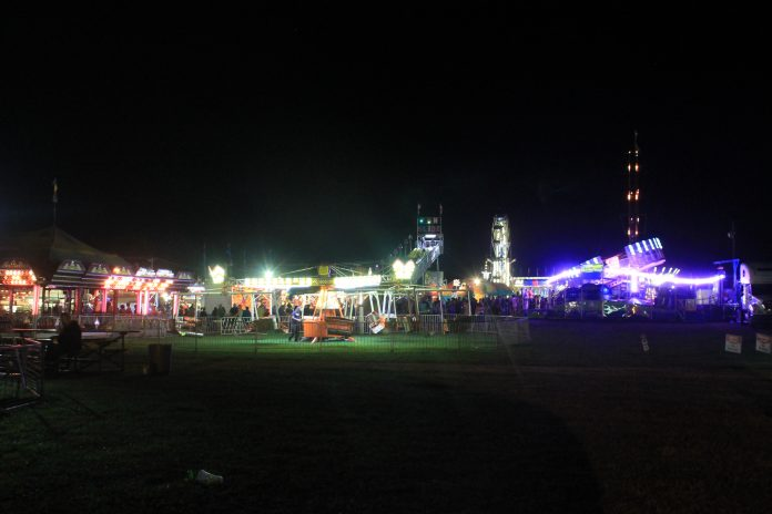 A farm show with lights in the evening.