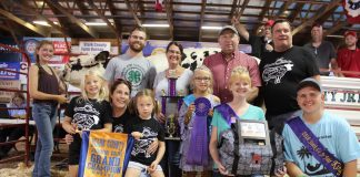Morgan Campbell sold the grand champion dairy cheese for $6,000 to Paris and Washington Insurance, and Wallace Farms Feed & Drive-Thru.