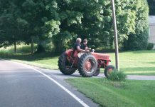 Two riders on tractor
