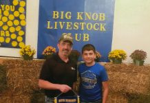 Josh Yeck and his 266-pound grand champion hog