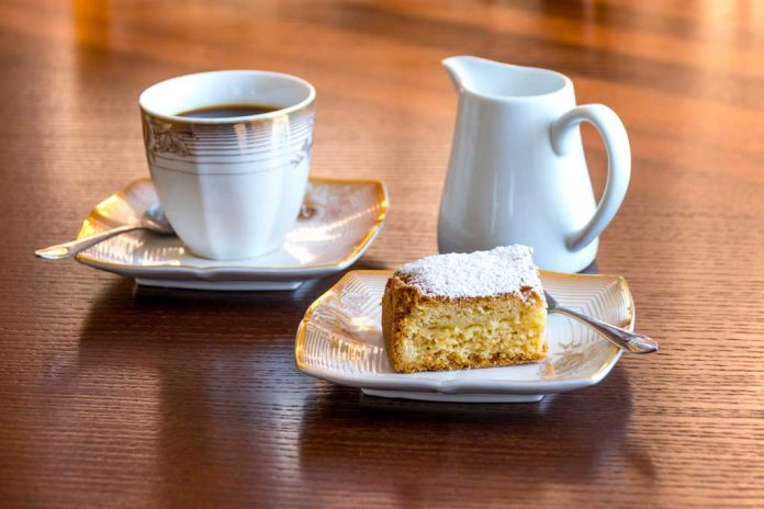 A slice of Cottage Pudding with a cup of coffee