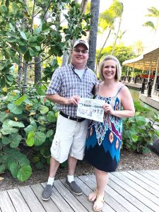 Couple reading the Farm and Dairy in Aruba