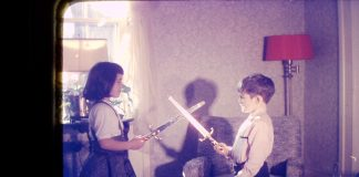 Kym Seabolt in a childhood sword fight.