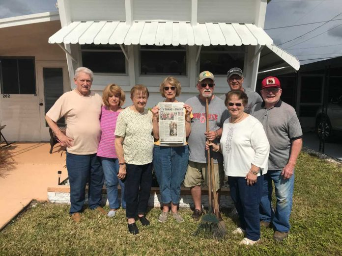 Vacationing in Palmetto, Florida a group of friends stands in front of a window with an awning