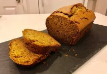 Pumpkin Bread on a slate cutting board with slices.