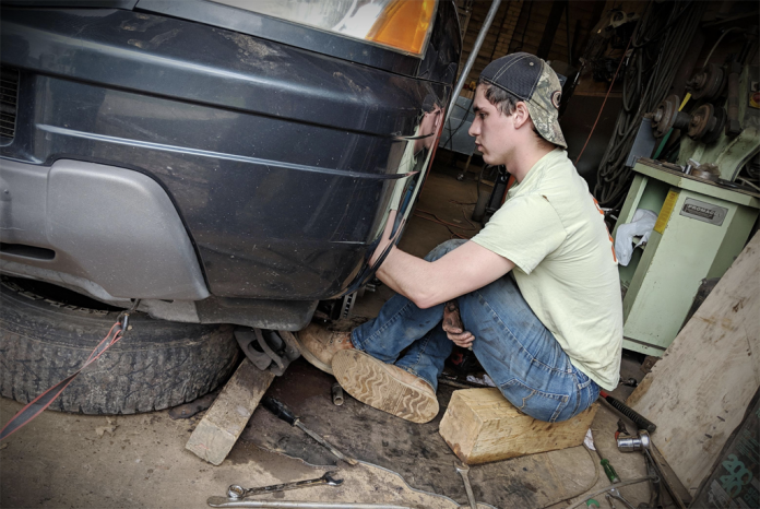 BoyWonder repairing his vehicle