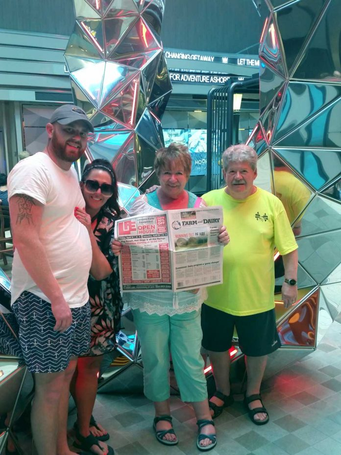 Janet Keene (holding Farm and Dairy), Lyle Printing commercial printing sales manager, and her husband Randy, of Salem, Ohio, cruised with Janet's daughter and son-in-law, Chris and Tema Jordan, on the Symphony of the Seas recently. The boat is the largest cruise ship in the world.