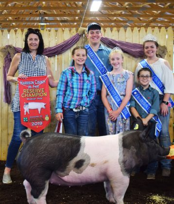 Jaiden Pelegreen's reserve champion market hog sold to Liggett Enterprises for $11.50 per pound.