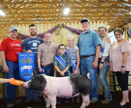 Grayden Sproull's grand champion market hog sold to buyer Paris & Washington Insurance and D&J Sales and Service for $15 a pound.