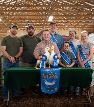 Grayden Sproull's grand champion duck sold to Encino Energy for a record $2,000.