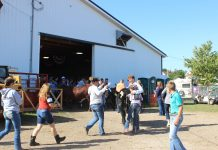 Friends and family congratulate Billy Kegley after he wins beef showman of showmen.