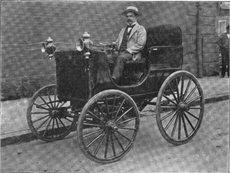 A man driving an old car