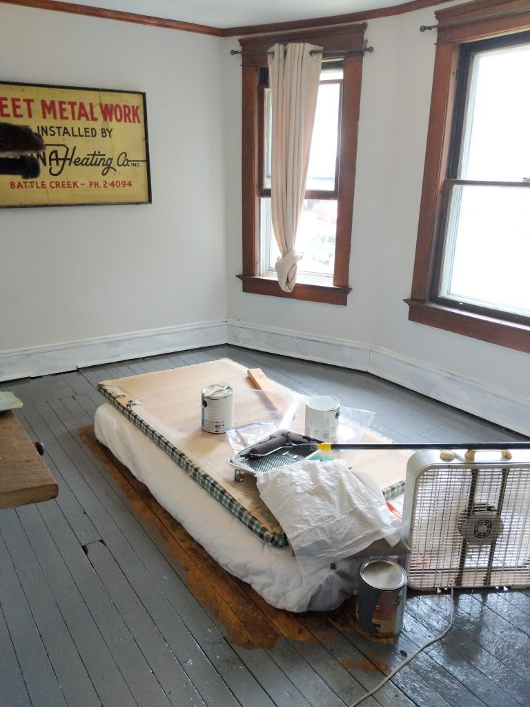 the partially-painted floor of a room in Kym Seabolt's house