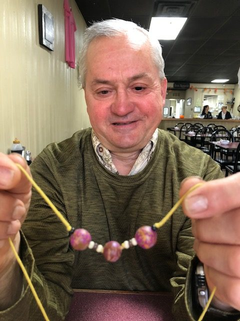 Chuck Defer holding his beads