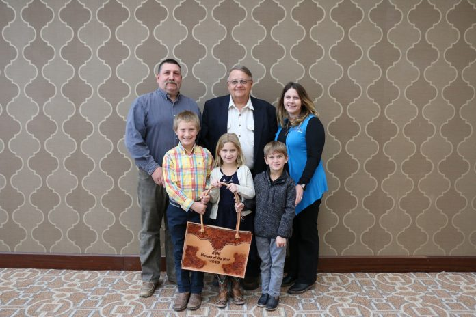 Pictured accepting the 2019 Hereford Woman of the Year award on Sandy's behalf (from left) are Tom Ostgaard, Tucker Ostgaard, John Ostgaard, Riley Evoniuk, Kurtis Evoniuk and Erika Evoniuk.