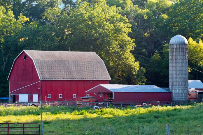 a red barn on a farm.