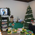 Agricultural toys under a Christmas tree.