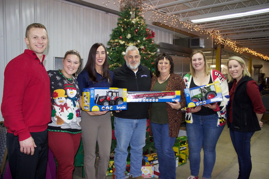 Organizers for the Ag Toy Drive standing with a couple who donated some toys.