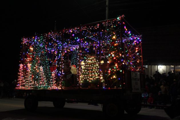 hay wagon turned into lighted tractor float