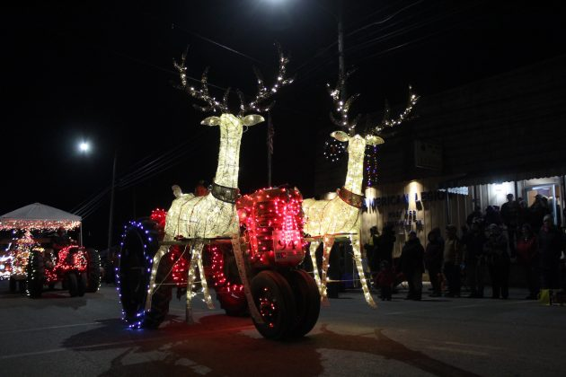 reindeer on lighted tractor