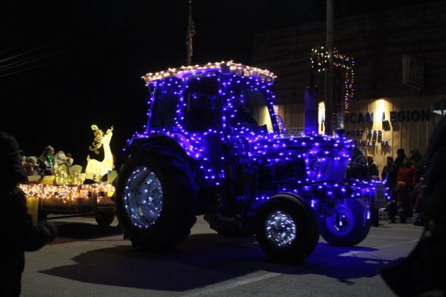 blue tractor in parade
