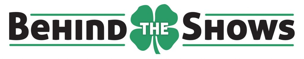 "A four leaf clover with the words ""behind the shows."""