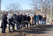 friends and supporters of the fair line up with shovels for the groundbreaking.