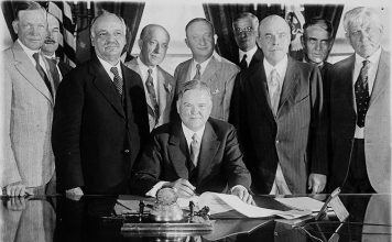President Herbert Hoover signing the Farm Relief Bill in 1929.